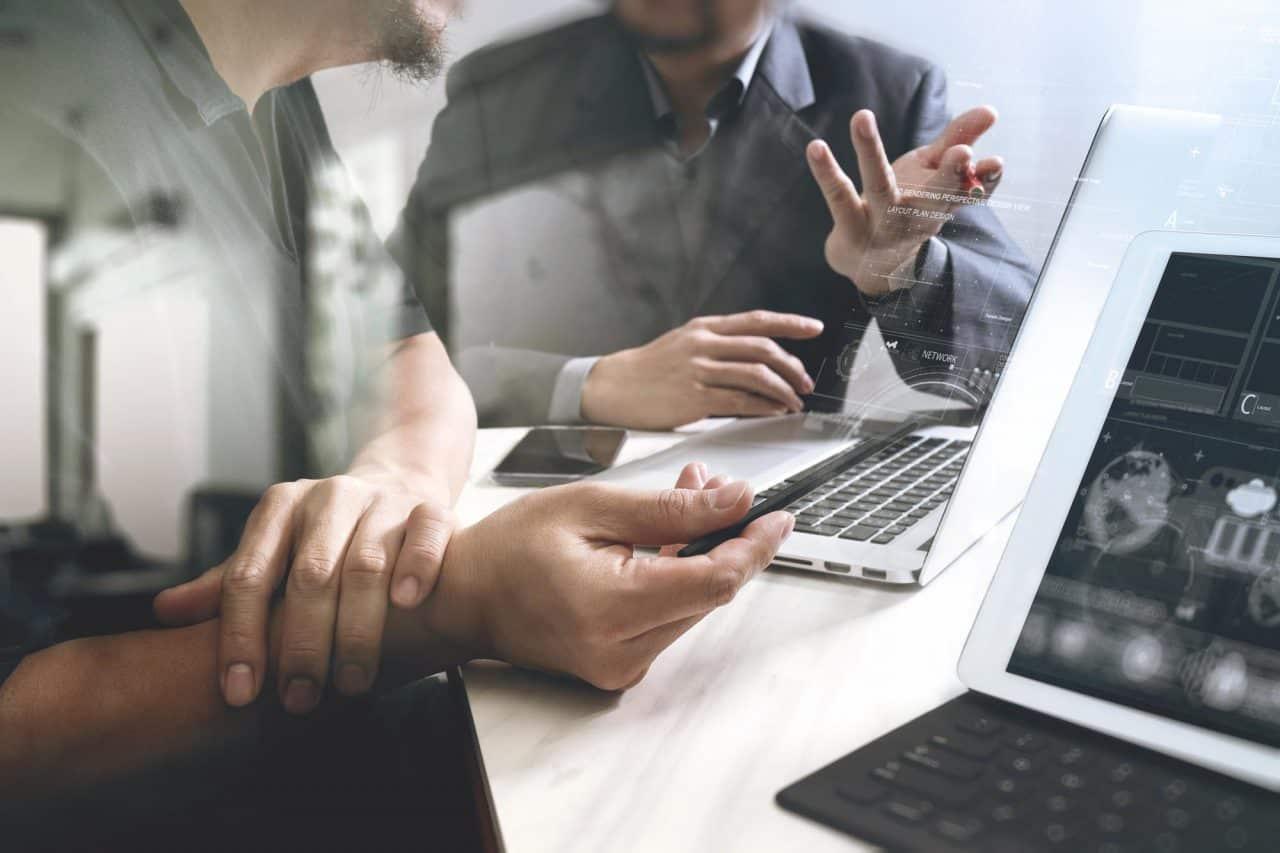 Business team meeting. Photo professional investor working new start up project. Finance task.Digital tablet docking keyboard laptop computer smart phone using, filter film effect